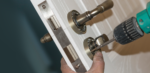 New lock being fitted to a door